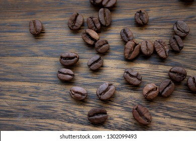 Coffee beans isolated on wooden background