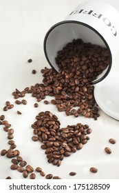 Coffee Beans in a jar. Coffee beans shaped like a heart