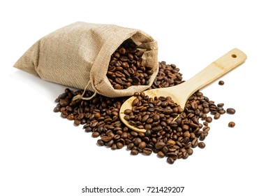 Coffee beans in jute sack  with wooden spoon isolated on white background