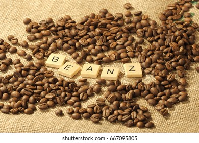 Coffee beans, and the letters BEANZ on a hessian background