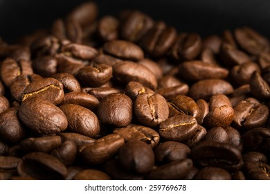 Coffee beans looking a rich brown color.