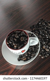 coffee beans in love cup