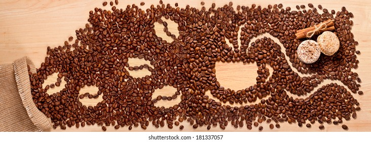 coffee beans and macaroons on wooden background
