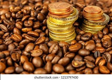 Coffee beans and money. Fair Trade. Sale of coffee. Commodity trade. Fresh coffee beans. Column of Euro coins