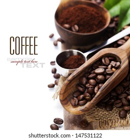 Coffee beans and an old wooden scoop (with sample text)