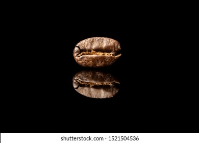 coffee beans on black backdrop reflection caffeine fresh roasted brown bean pick me up coffee break morning beverage room for text aroma smell good taste good