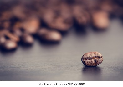 Coffee beans on a black background. Raw coffee beans. Grained product. Hot drink. Close up. Harvesting. Natural background. Energy