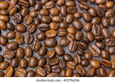 Coffee beans on black stone table