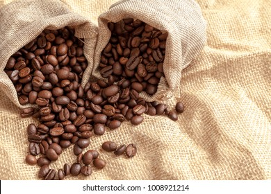 Coffee beans on the brown color fabric