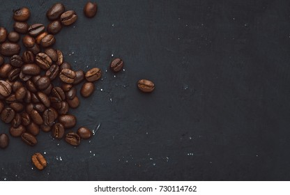 Coffee in beans on dark background. Abstract background texture.Coffee beans texture. Food background of coffee beans