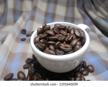 Coffee and coffee beans on fabric