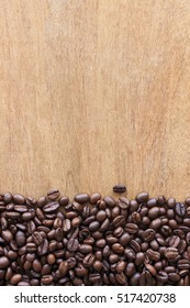 coffee beans on grain wood background