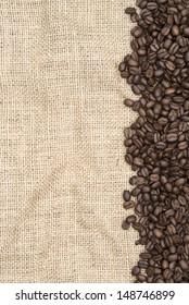 Coffee beans on hessian background as a border
