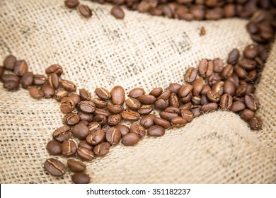 Coffee beans on rustic burlap sack