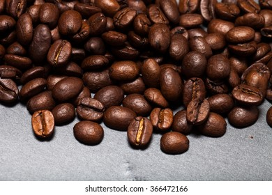 Coffee beans on the slate background.