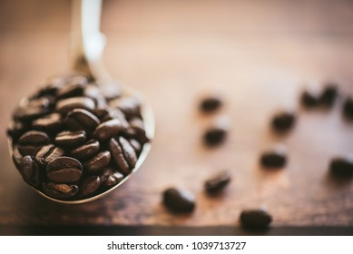 Coffee beans on a spoon.