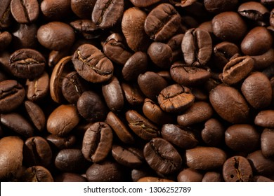 Coffee beans on the table background blurred abstract blurred