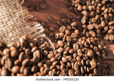coffee beans on a table with burlap.