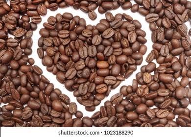 Coffee beans on white background. Valentines day. Heart. Coffee beans in ground coffee