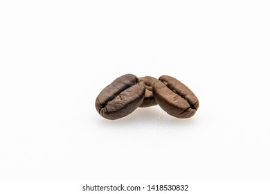 coffee beans on white background with bottom lights