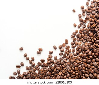 Coffee beans on white background with area for copy space.