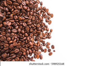 Coffee beans on white. Top view. Copy space.