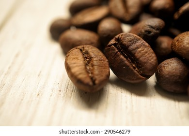 coffee beans on white wooden table background
