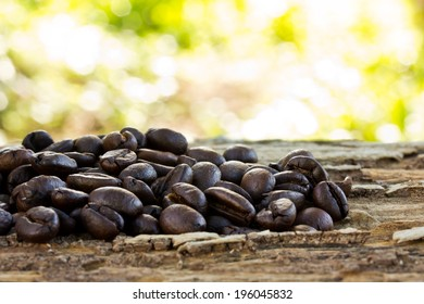 Coffee beans on wood background - Shutterstock ID 196045832