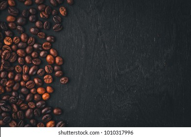 Coffee beans. On a wooden background. Top view. Copy space.