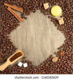 coffee beans on wooden background, top view