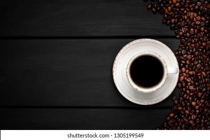 coffee and beans on wooden background