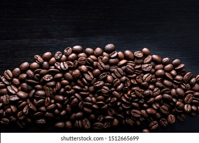 Coffee beans on wooden background. Macro.