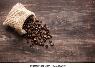coffee beans on wooden background and empty space