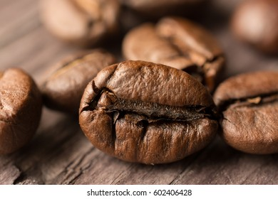 coffee beans on wooden board, closeup