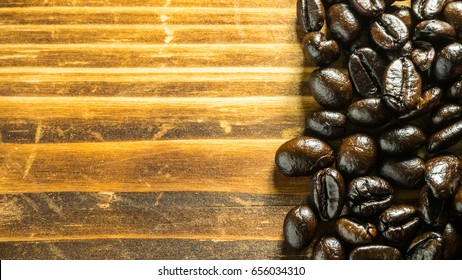 Coffee beans on wooden boards.