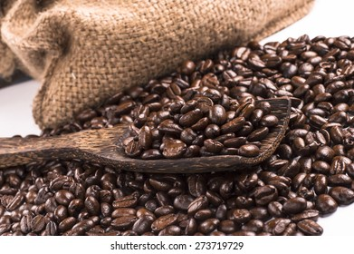 coffee beans on the wooden scraper with sackcloth