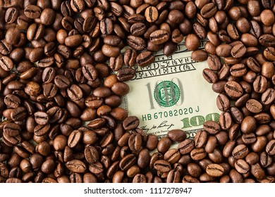 Coffee beans and one hundred dollar bill. Roasted coffee beans background. Financial concept