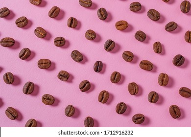 Coffee beans pattern on a pink background. Top view.