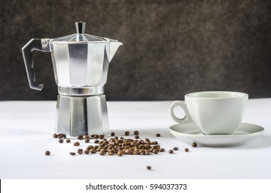 coffee beans, coffee pot and cup