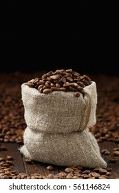 Coffee beans in a pouch with on a wooden desk