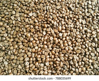 Coffee beans are roasted . Coffee beans brown and dark brown wallpaper from Chiang Mai, Thailand.