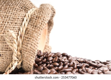 Coffee beans roasted in jute sack. isolated white background.