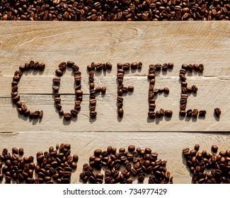 Coffee beans in rustic, natural, wooden coffee sign - design for caffeine lovers in writing / words / letters.