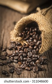 Coffee beans in sack on wood table