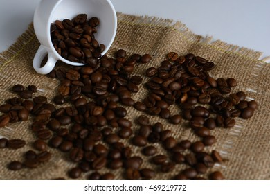 Coffee beans scattered on burlap