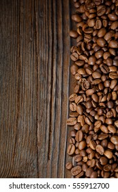 coffee beans are scattered on a dark background