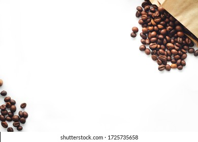 coffee beans are scattered on a white background.