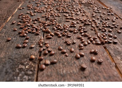 coffee beans scattered on the wooden table