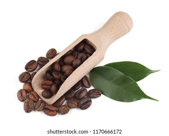 Coffee beans with scoop and leaves isolated on white background
