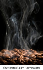 Coffee beans smoking.  Looking like they are being roasted.